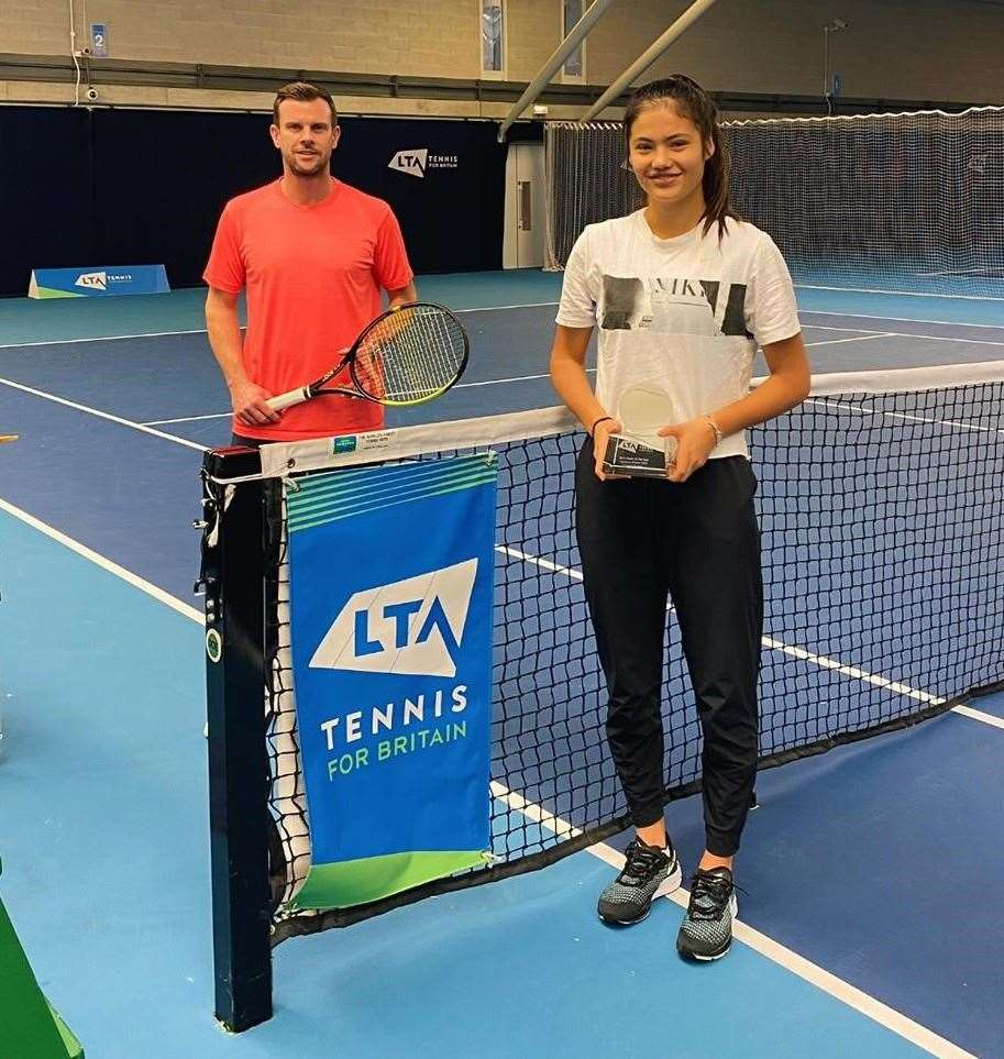 Emma Raducanu belatedly receives her LTA girls' player of the year award from GB Davis Cup captain Leon Smith at the National Tennis Centre