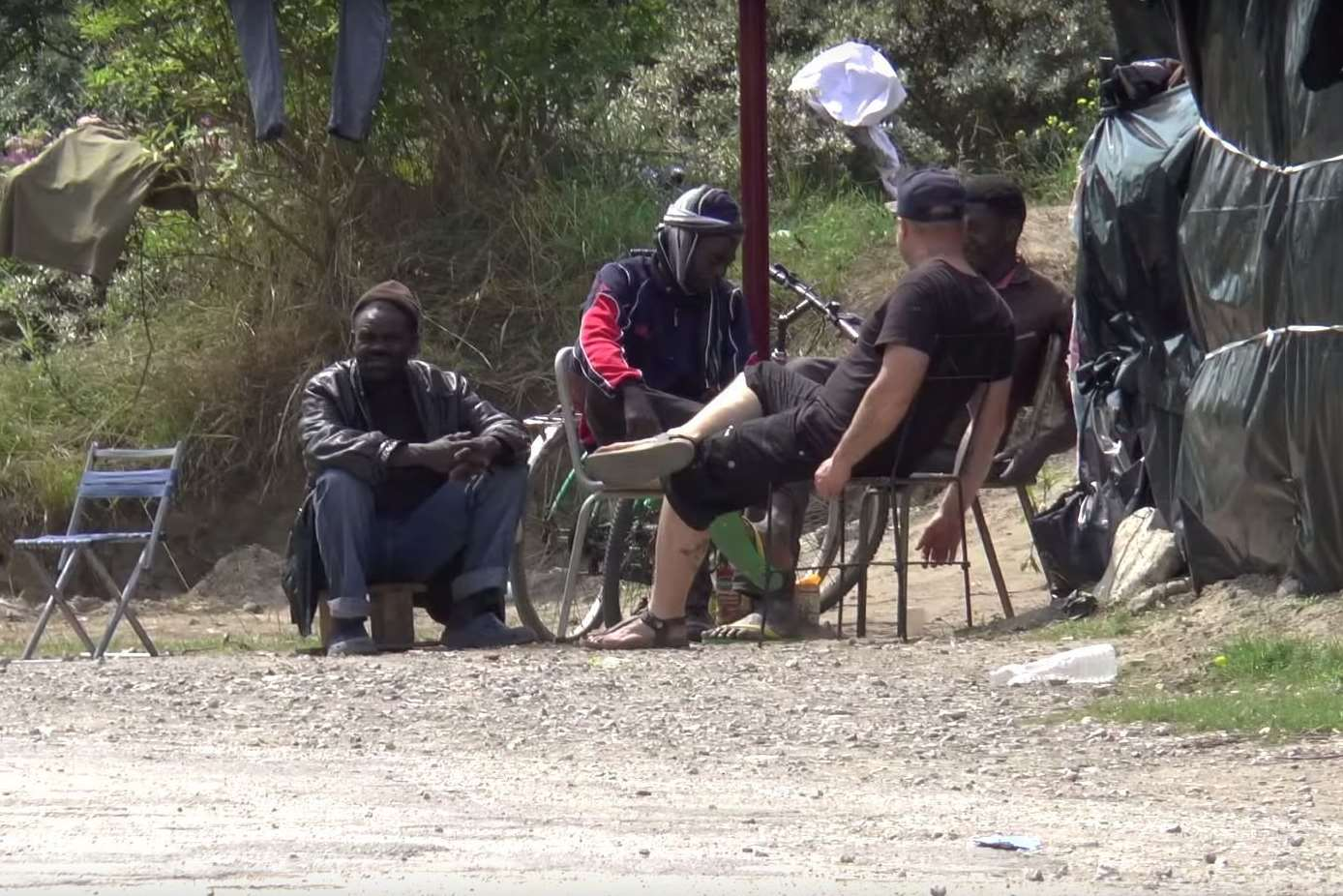 Migrants at the camp in Calais, near the Eurotunnel terminal