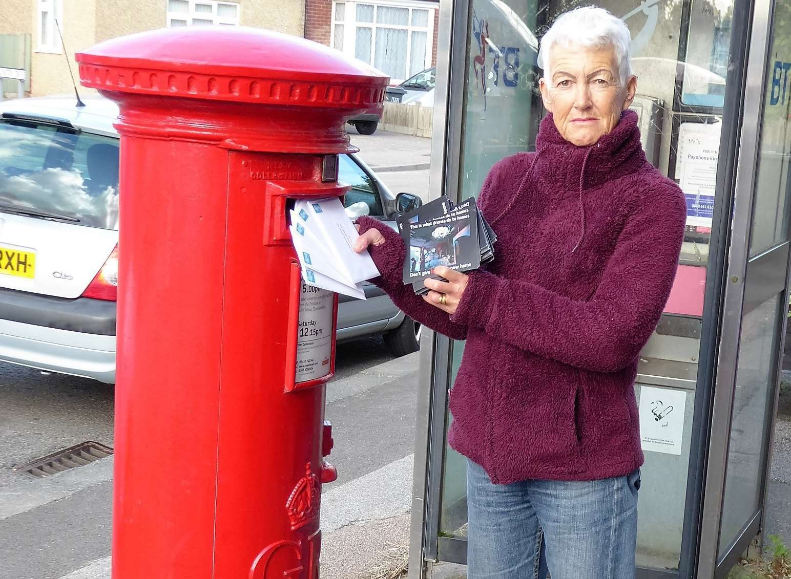 Ruth Simson posting the postcards to Discovery Park in Sandwich