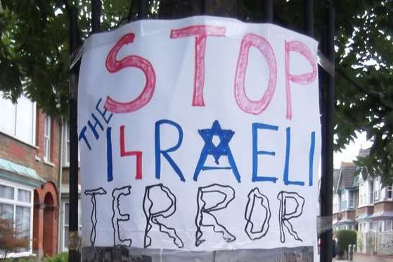 The poster reads: Stop the Israeli terror on civilians