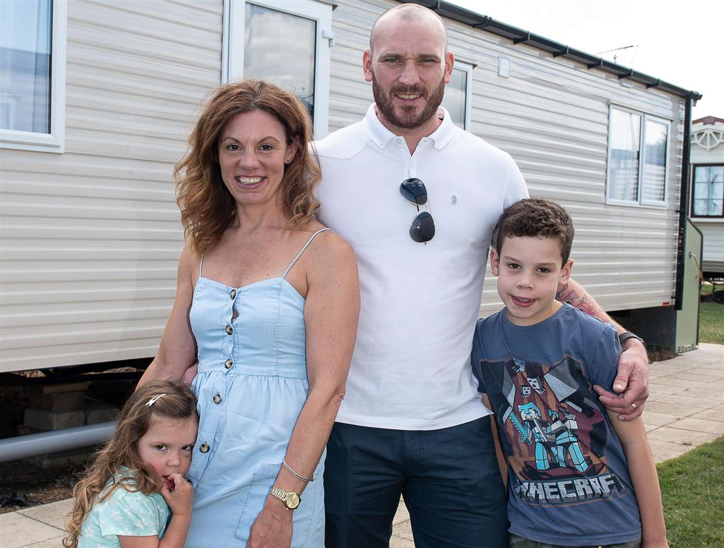 Rosie, Emma, Dean and Euan Giles outside the caravan