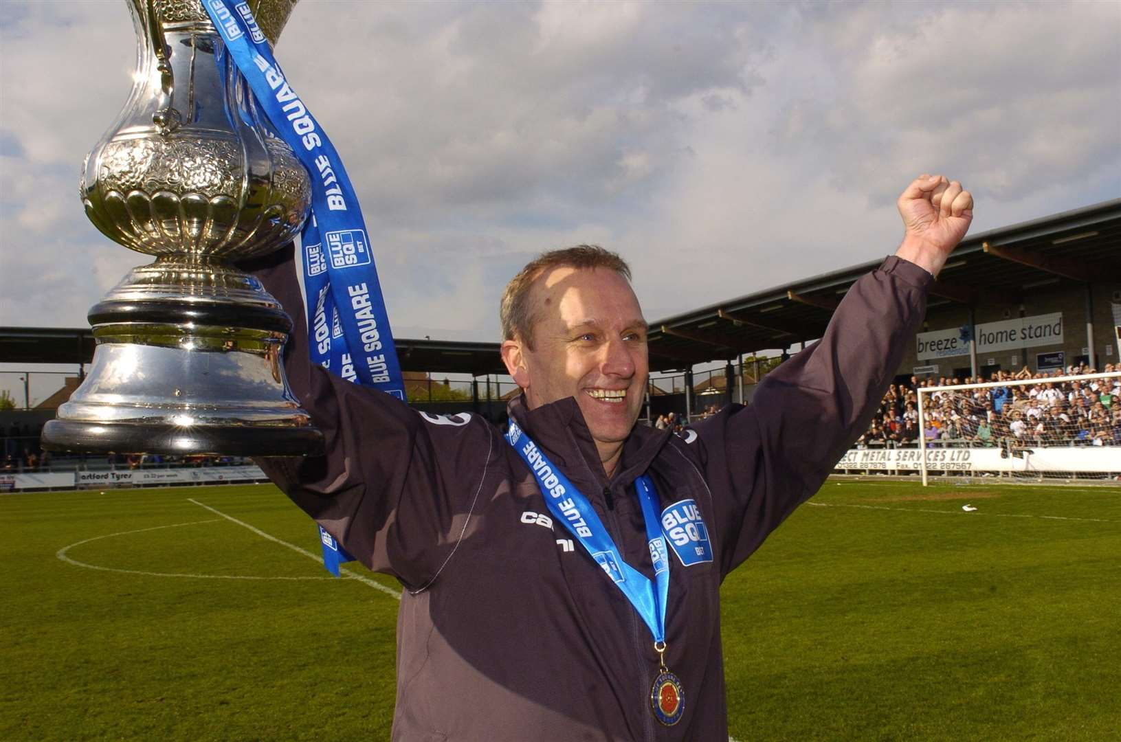 Tony Burman celebrates promotion to the Conference in 2012 Picture: Steve Crispe