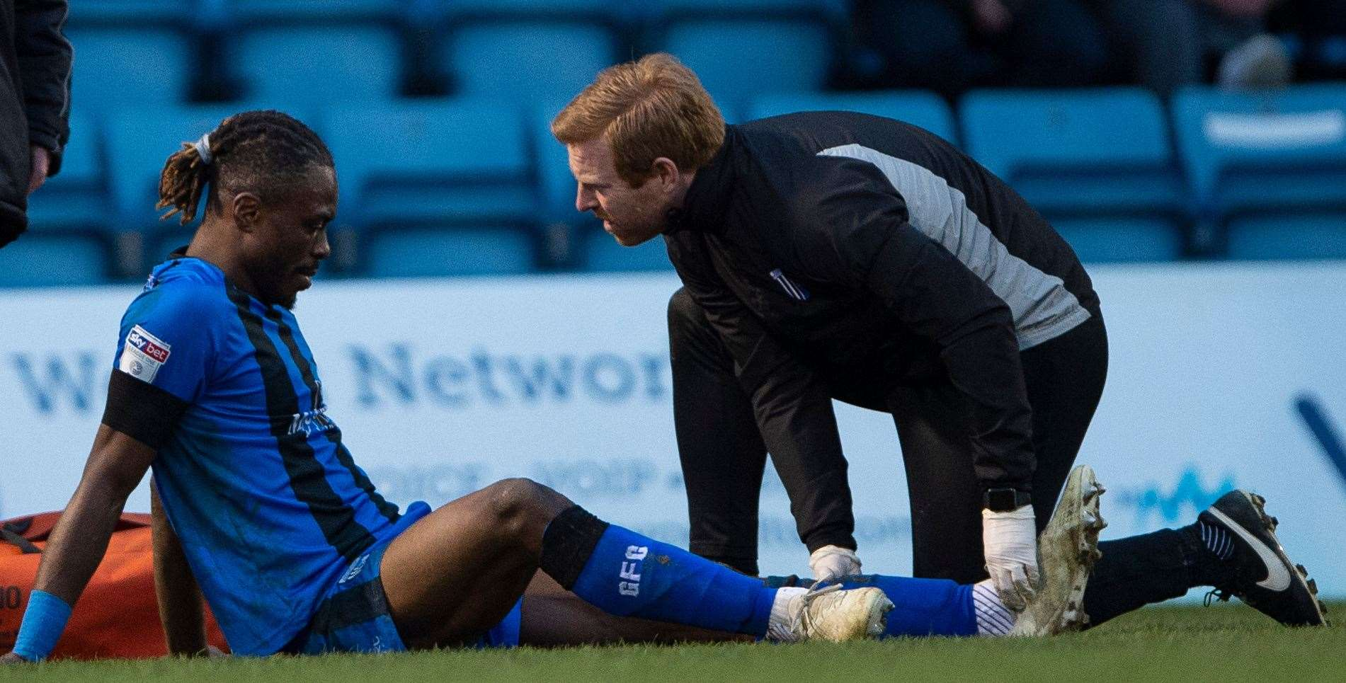 Gabriel Zakuani's ankle gets treatment during the match against Barnsley Picture: Ady Kerry