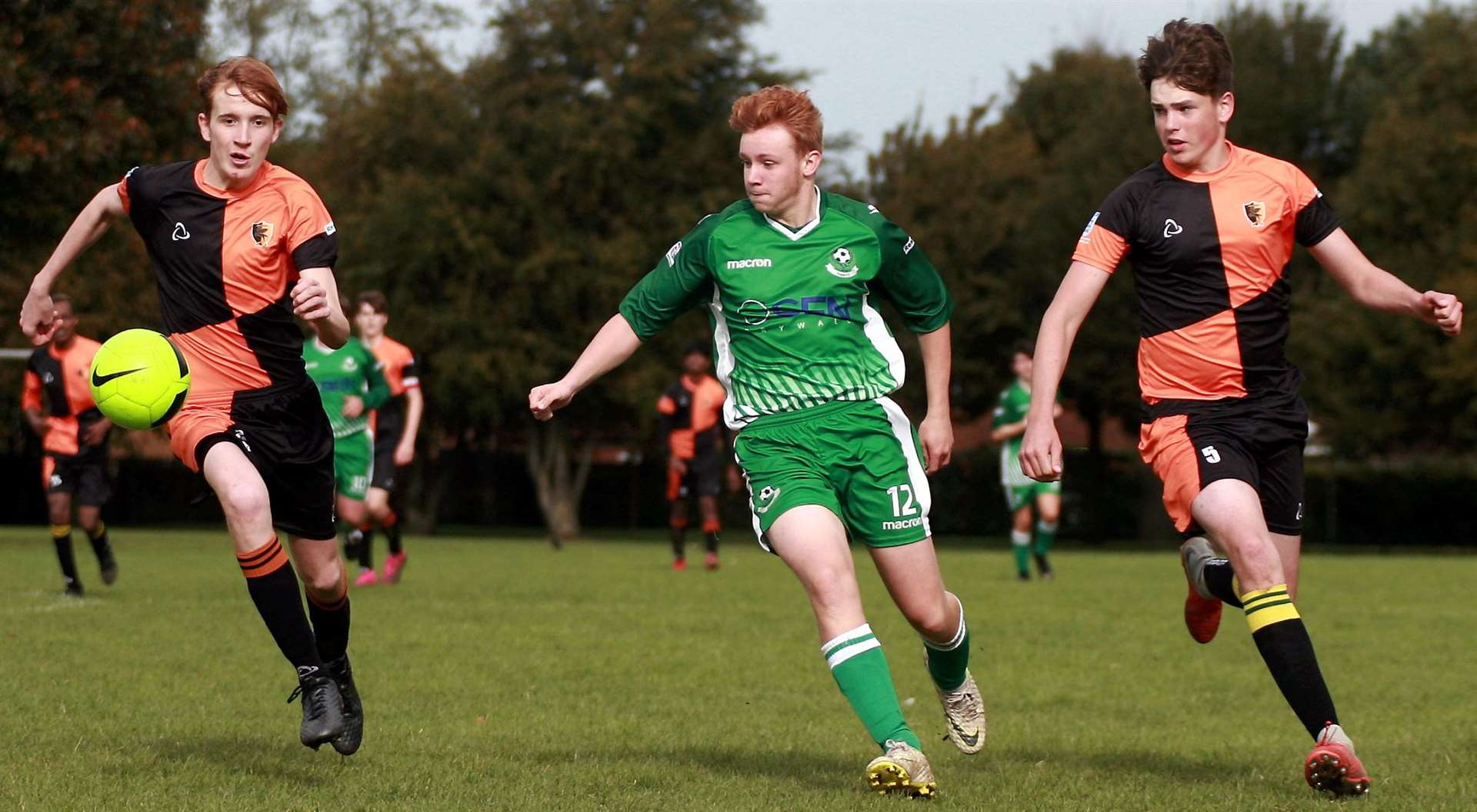 Pegasus 81 Flyers under-18s (green) give chase against Eagles Gold under-18s Picture: Phil Lee FM18684290
