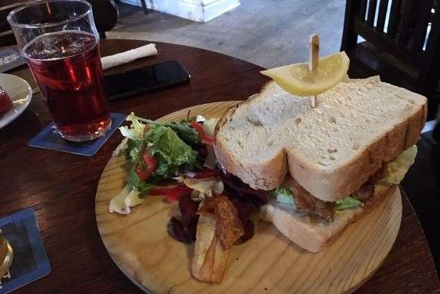 At the Woolpack, Chilham the fish finger sandwich was well presented on a trendy wooden board but it didn't come cheap