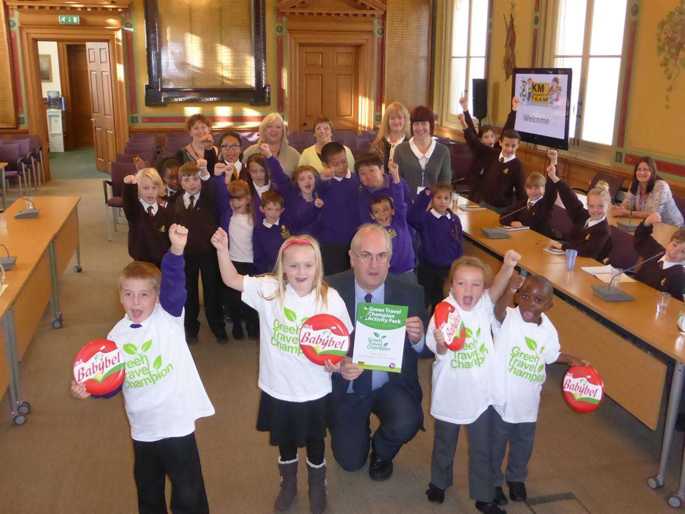 Maidstone Council Environmental Health Manager Steve Wilcock launches the Green Champion scheme supported by Archbishop Courtney pupils David Smith, seven, Jasmine Woodridge, eight, Mya Riddell, six, and Kenan Minta, four, cheered on by school delegates.