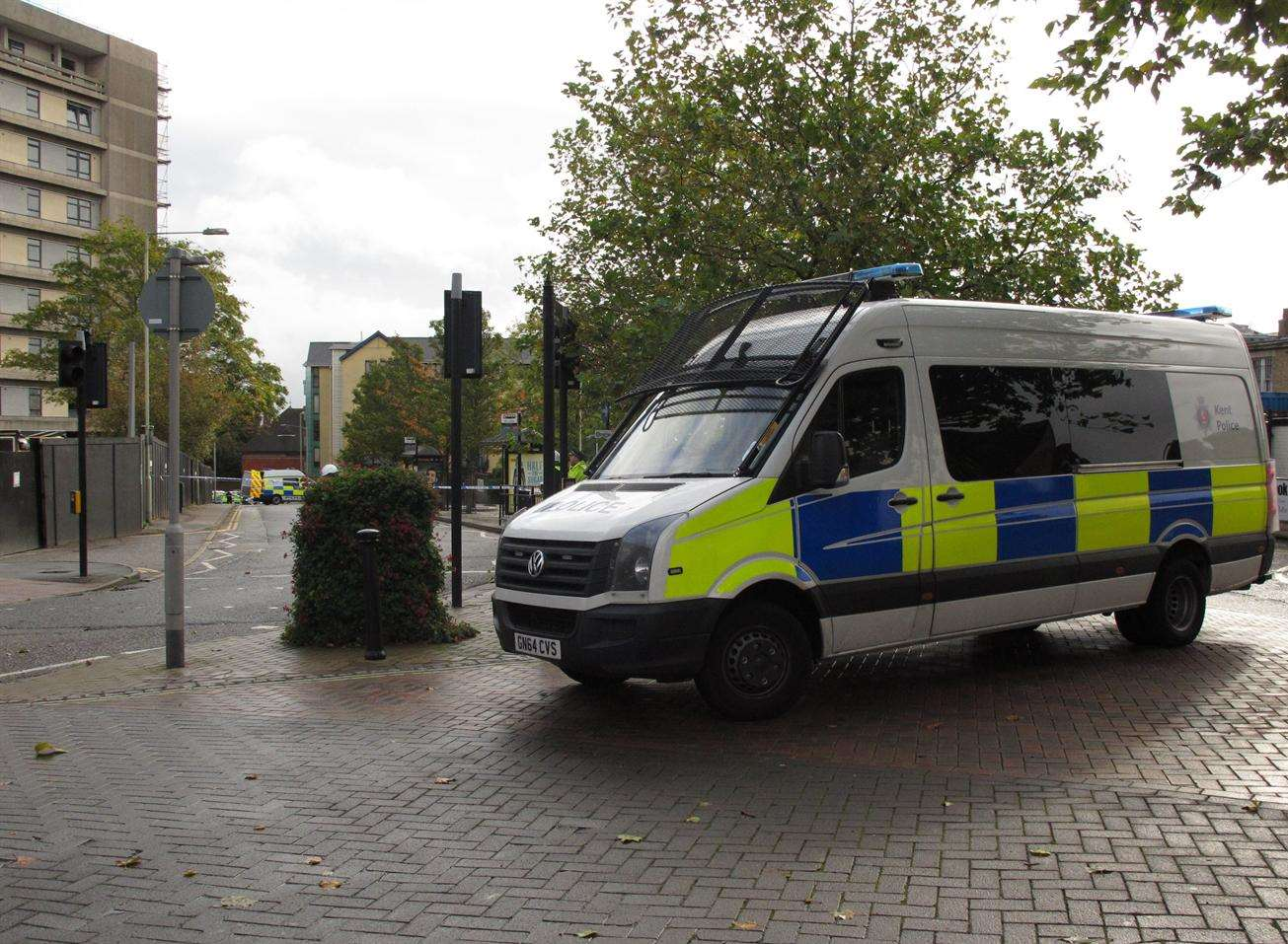 A police van parked outside the Panorama building, where Mr Males's body was discovered