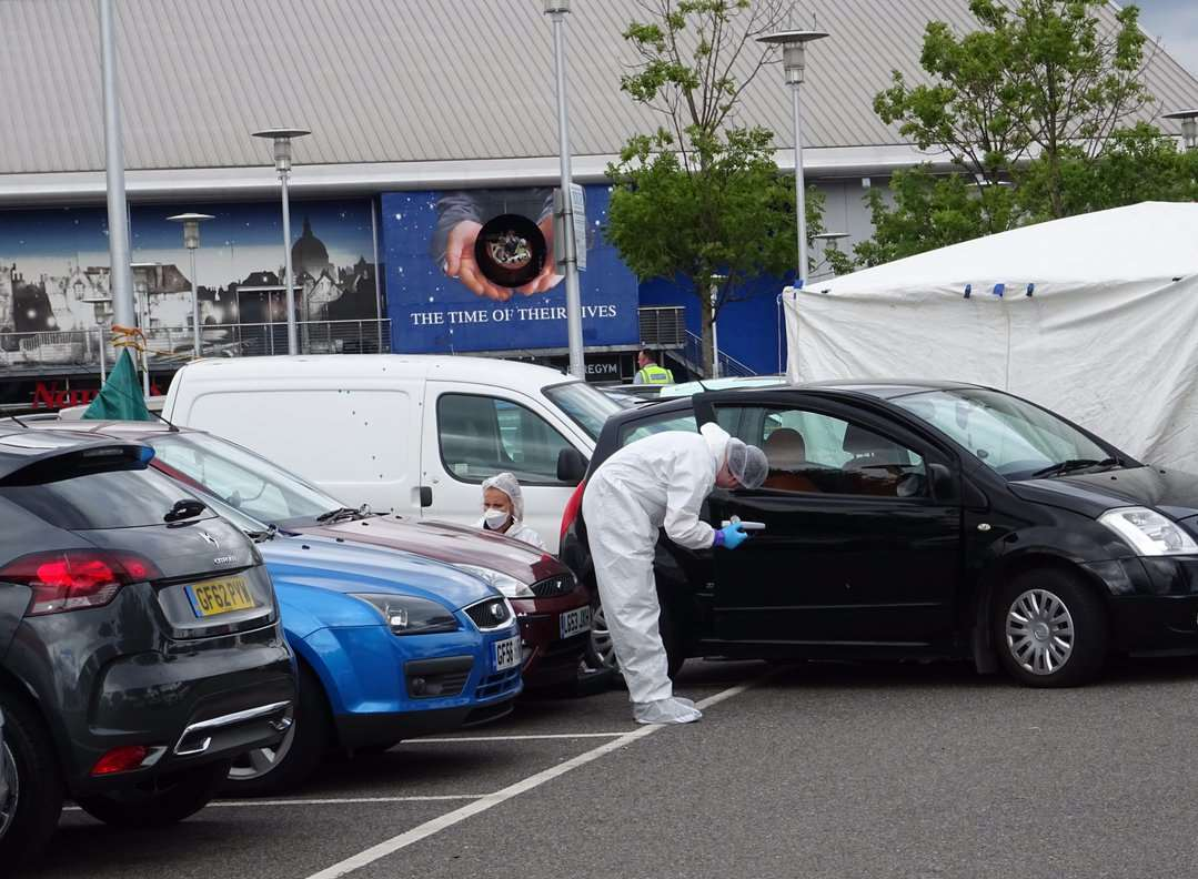 Forensics officers scour through potential evidence. Picture: Tom Smy (@EastKent999vids)
