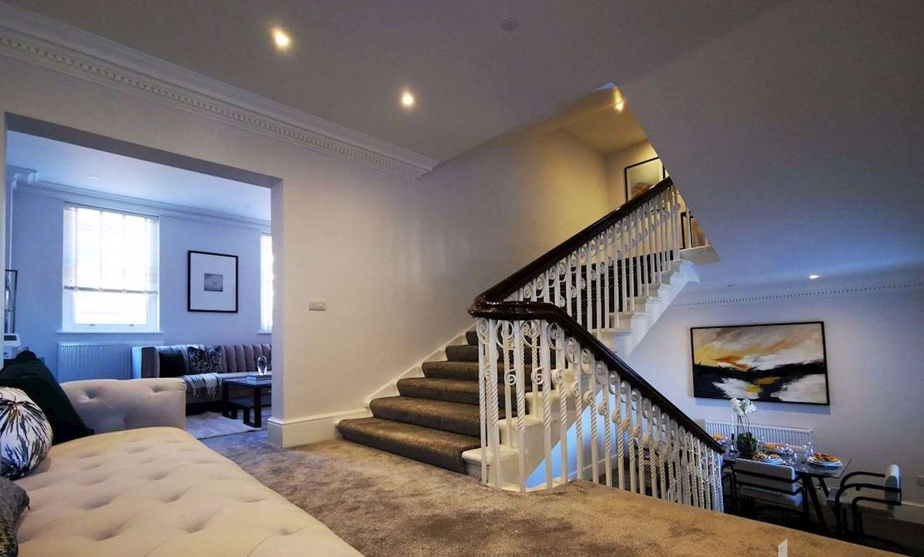 The split levels on the apartment centred around the main staircase offer additional space and spread the property across multiple floors. Picture: Haart Medway