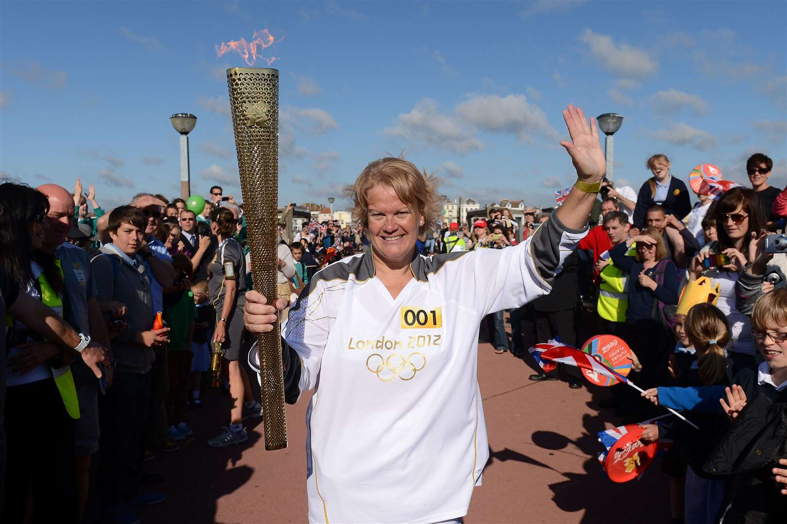 Torchbearer Katherine Batts holds the flame in Deal at the beginning of Day 62
