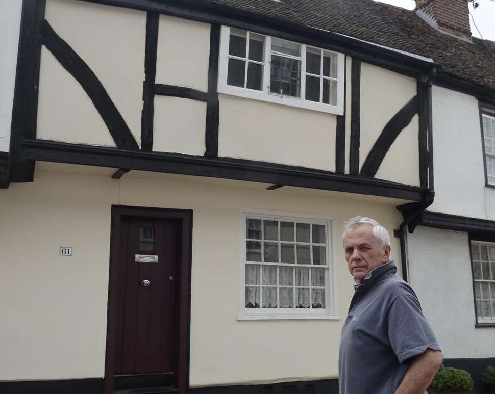 David Gwyn-Jones outside his home in Faversham showing the height from which Rosie fell. Picture: Chris Davey