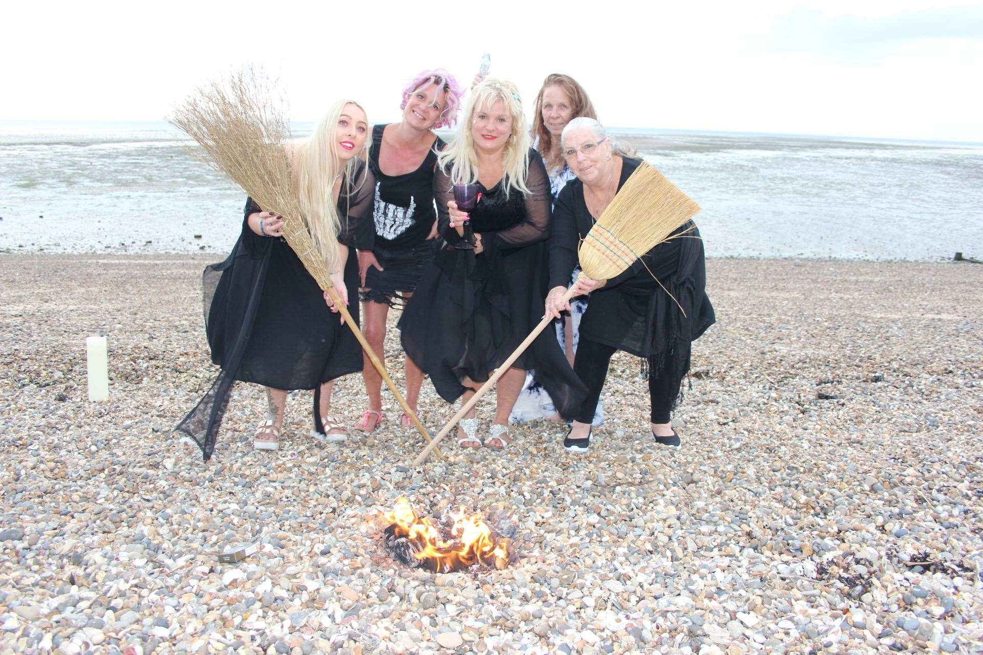 Sheppey witches on the beach at Minster with their broomsticks (16434552)