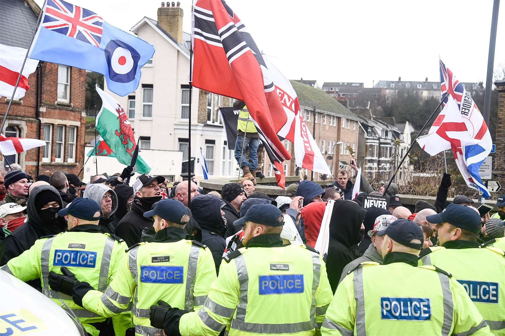 Police holding back far right at the Dover race demonsrations, January 30, just before violence erupted.