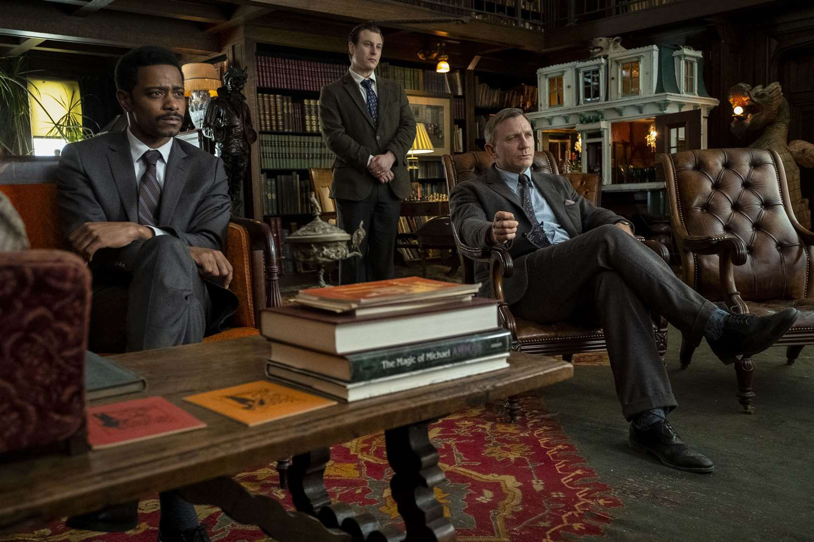 Lakeith Stanfield as Detective Lieutenant Elliott, Noah Segan as Trooper Wagner and Daniel Craig as Benoit Blanc in Knives Out