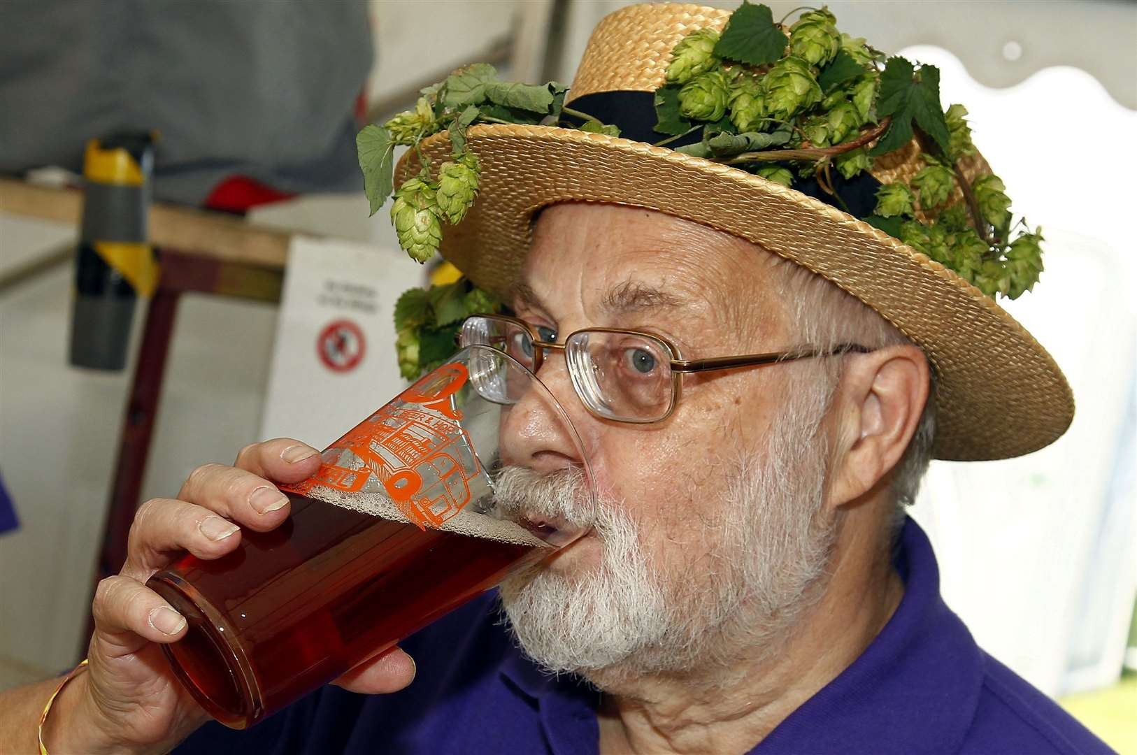 John Mills tries some ale at the festival at East Malling Research Centre last year Picture: Sean Aidan