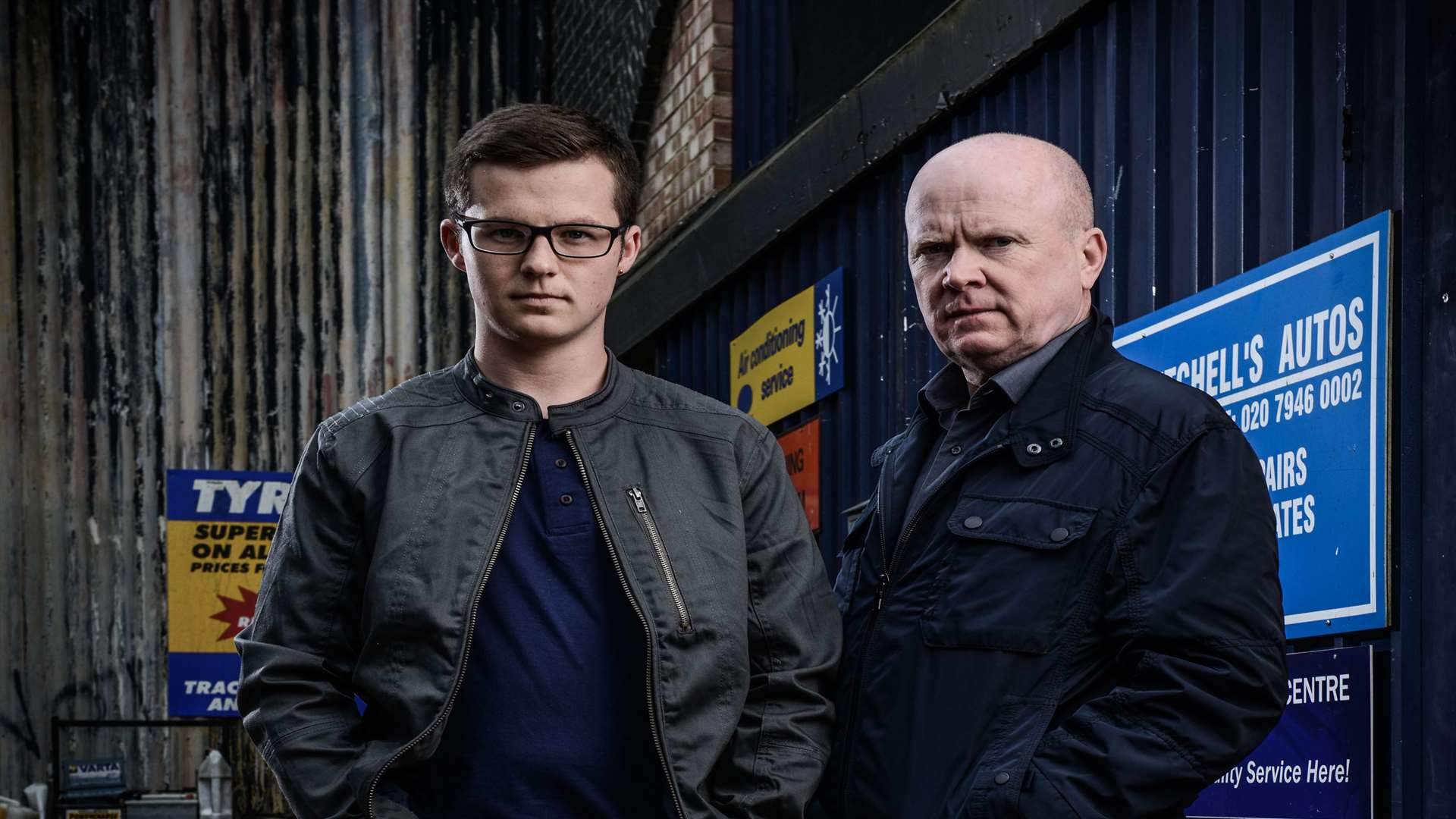Harry Reid, who plays Ben Mitchell, with his on-screen dad Phil Mitchell, played by Steve McFadden. Picture: BBC/Kieron McCarron.