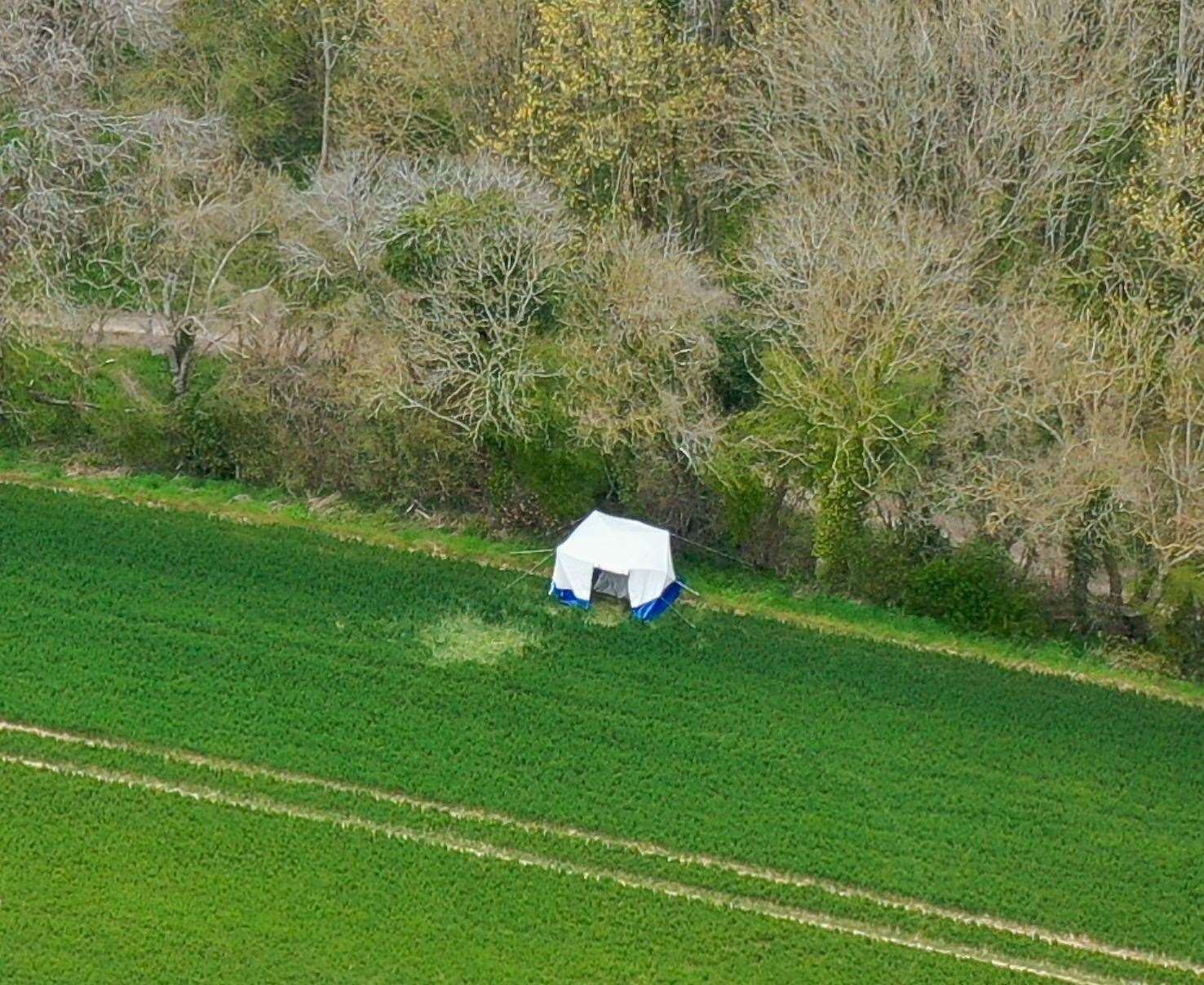 A police tent in a field in Snowdown where officers found the body of PCSO Julia James. Picture: UKNIP