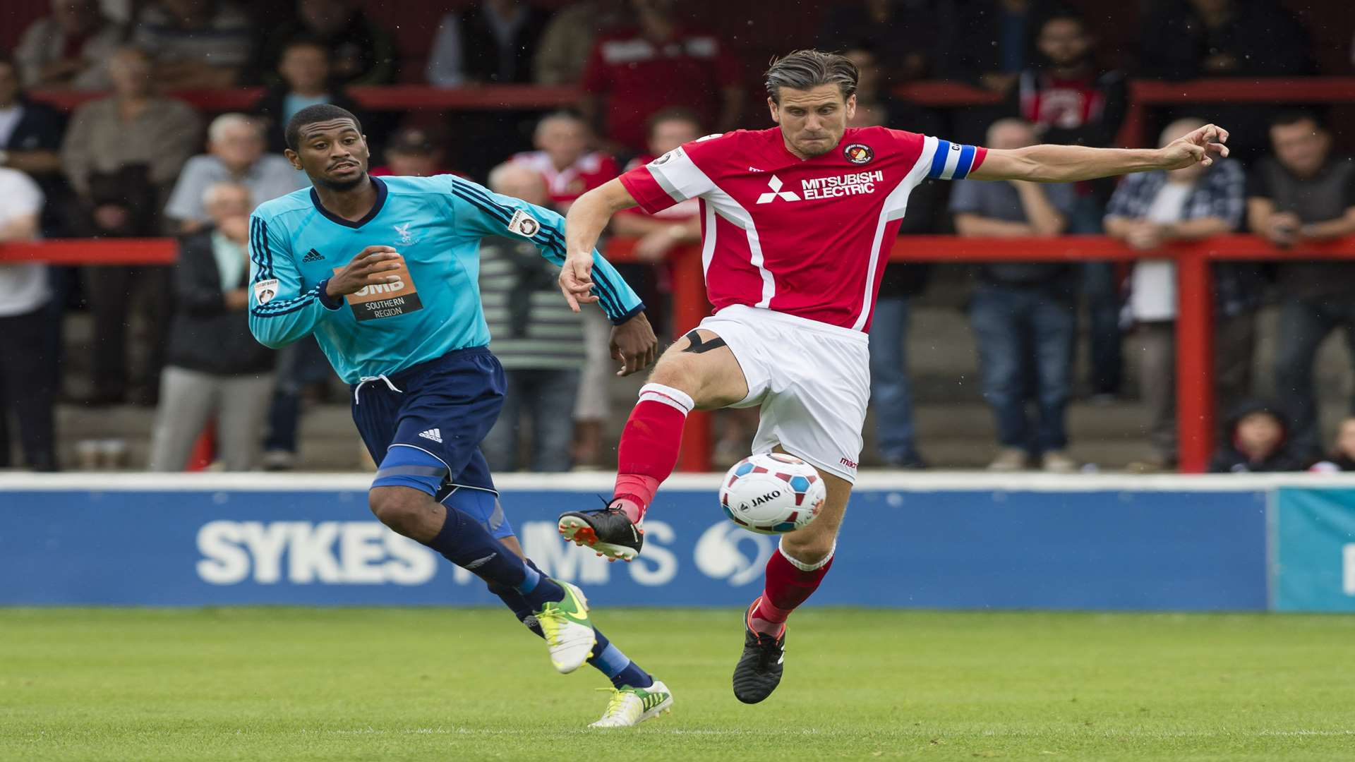 Ebbsfleet captain Tom Bonner gets to the ball ahead of Danny Mills Picture: Andy Payton