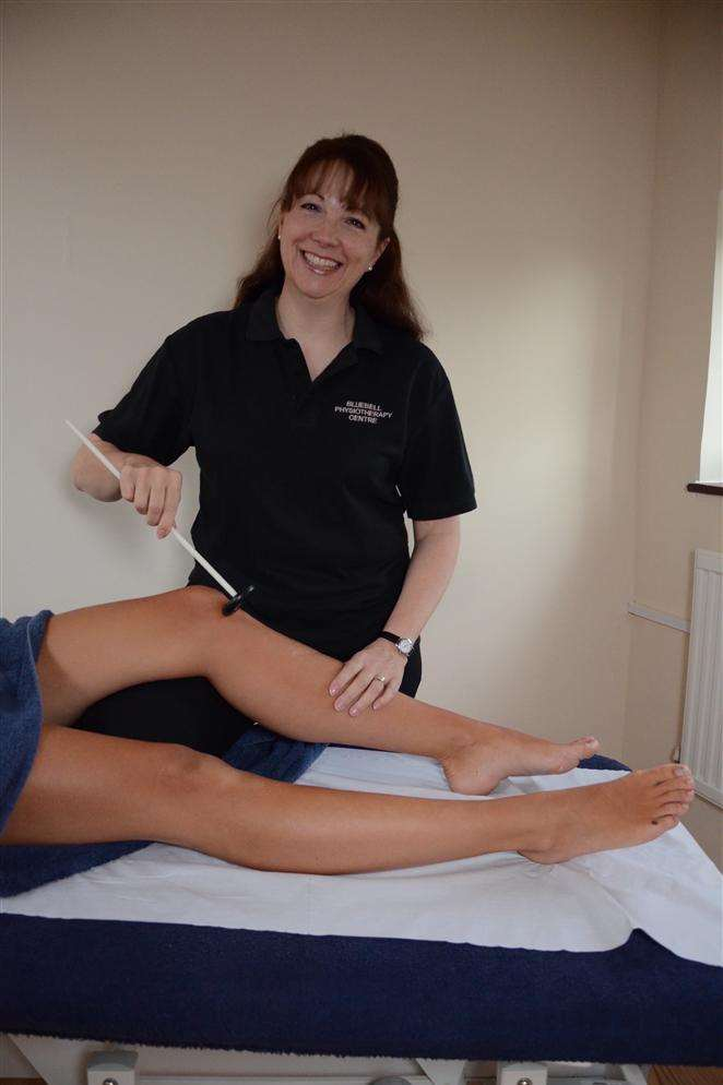 Melanie Poynter treating a patient at Bluebell Physio Centre