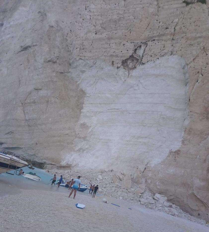 Holidaymakers moved away from cliff face but feared more could fall