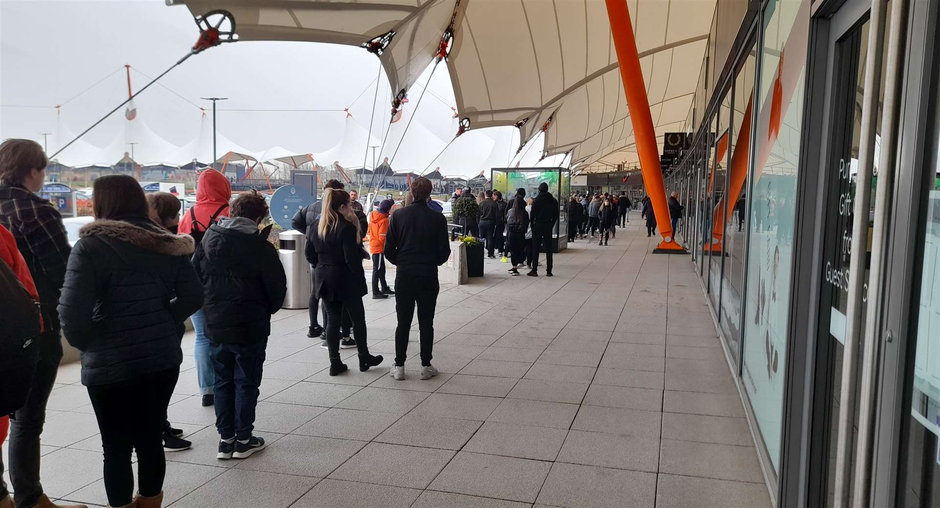Even with a little bit of snow in the air, the Designer Outlet was busy first thing this morning