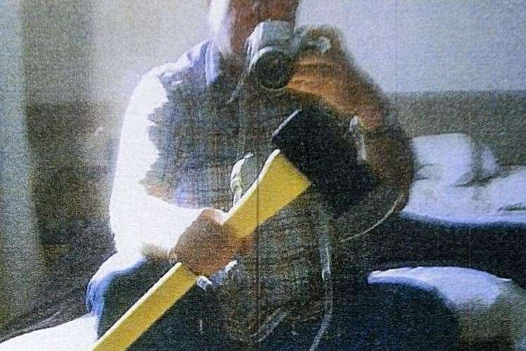 Dale Bolinger photographed himself with the axe he bought
