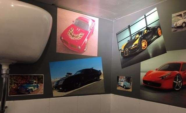 Racy looking cars featured on the wall of the gents