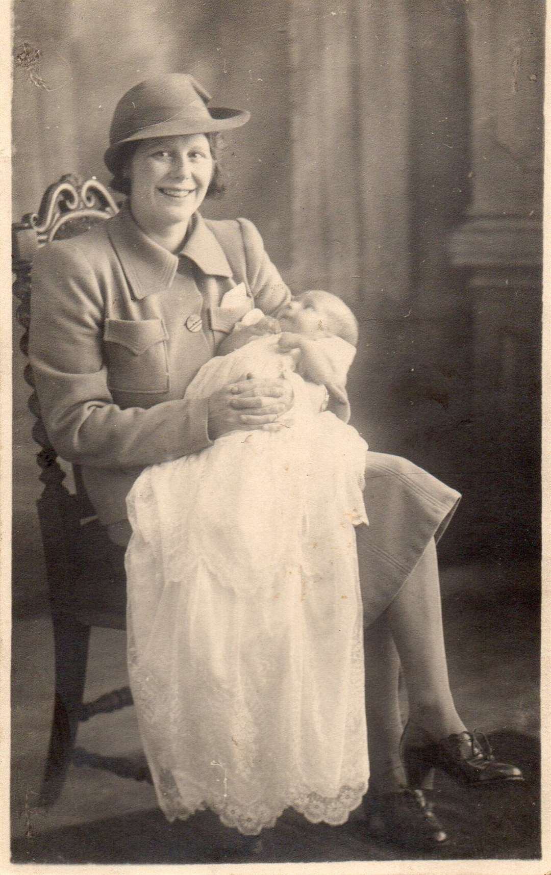 Ted Honey as a baby being held by his mother Violet