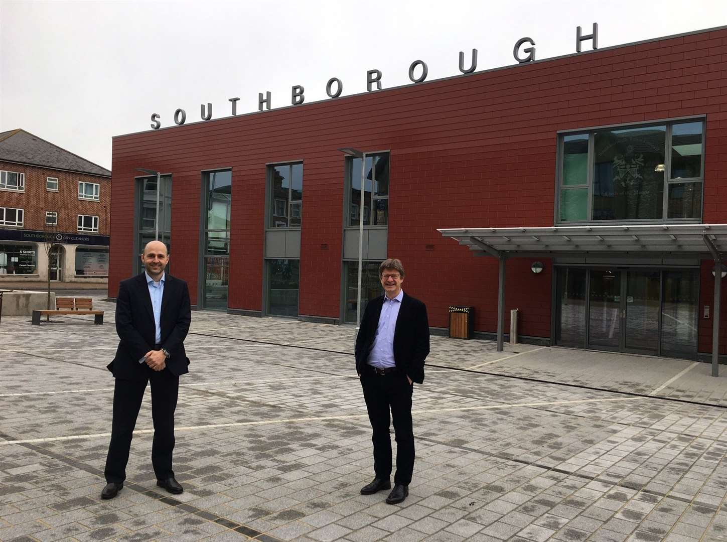 Project manager Jonathan White, left, with MP Greg Clark outside the new civic centre in Southborough