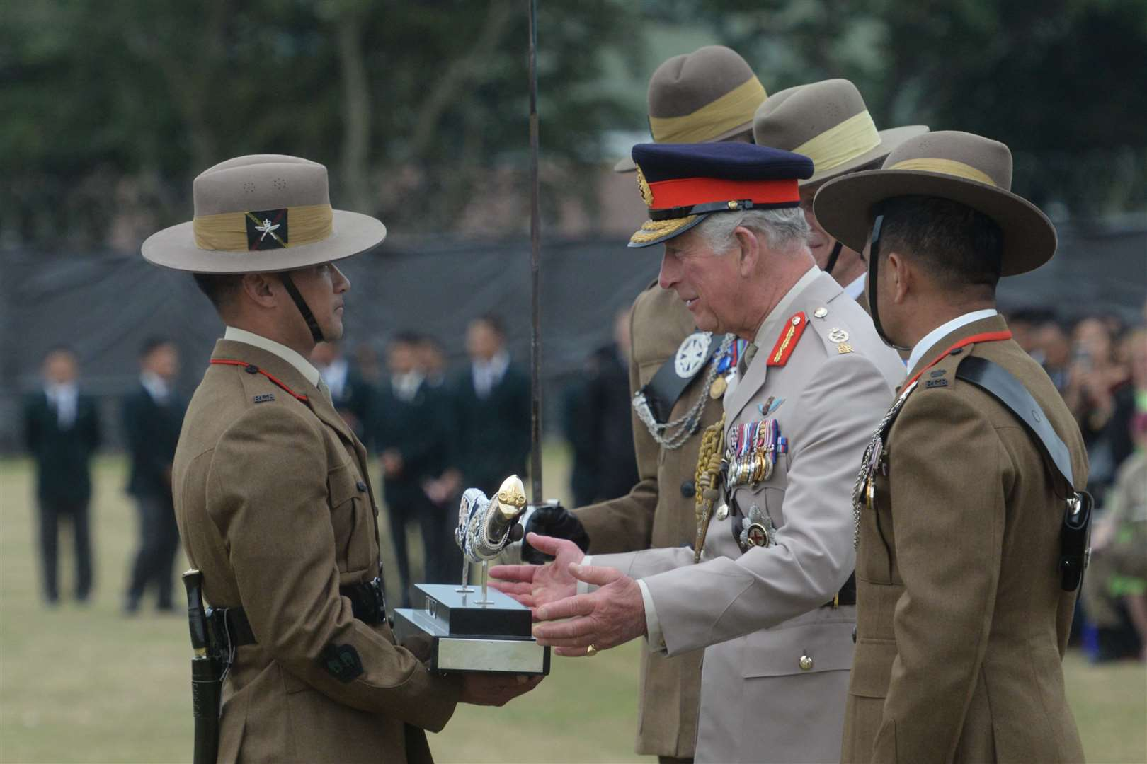 Prince Charles makes the presentation to WO2 Mukunda Rajali. Picture: Chris Davey