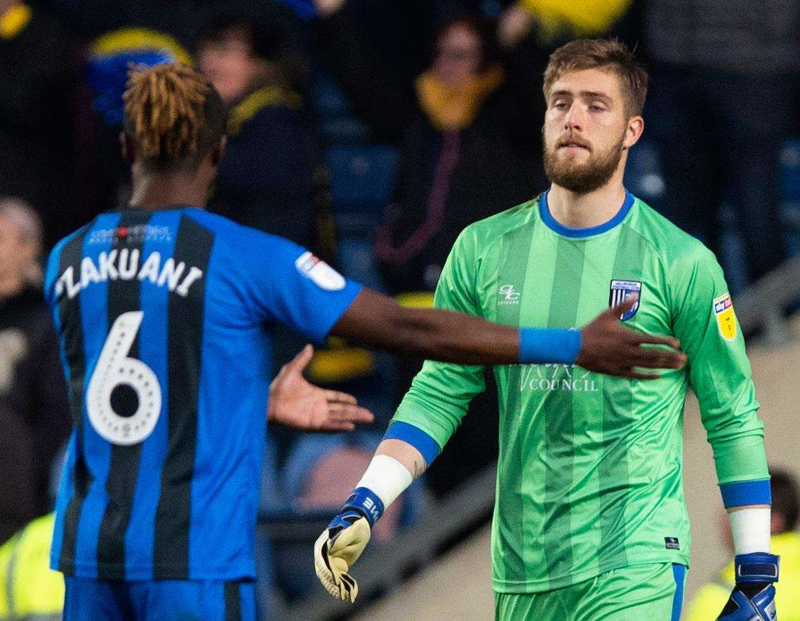 Frustration for Gills skipper Gabriel Zakuani after Tomas Holy's clash with Marcus Browne gave Oxford a penalty Picture: Ady Kerry