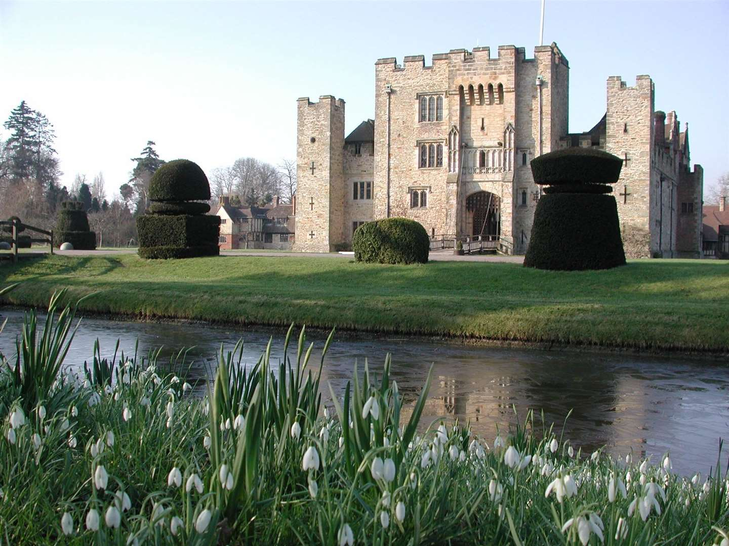 Hever Castle surrounded by snowdrops