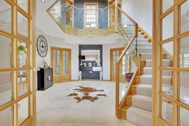 The central hall atrium is a striking feature of the house. Picture: Zoopla / Fine & Country