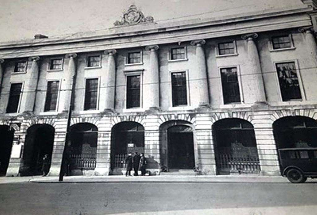 Photograph showing the front exterior of the building as the Kent Insurance Offices in the early 1900s