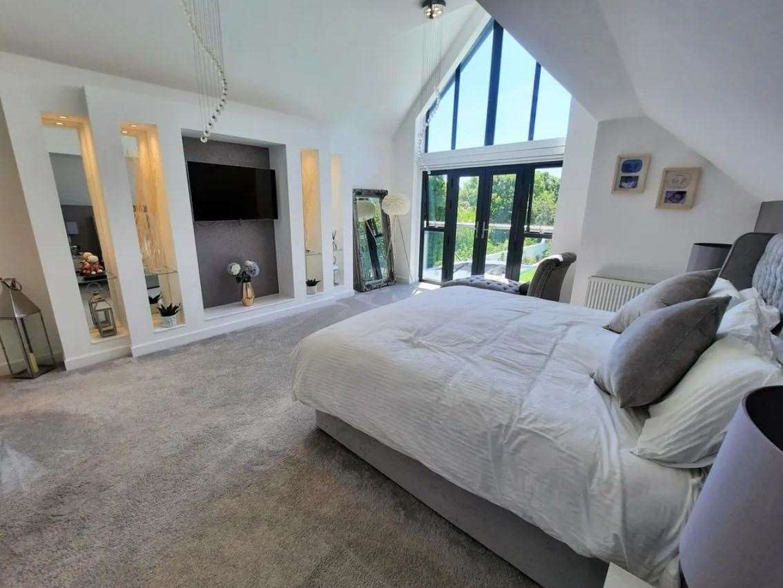 The main bedroom with cathedral-style window. Picture: Zoopla / Machin Lane Partnership