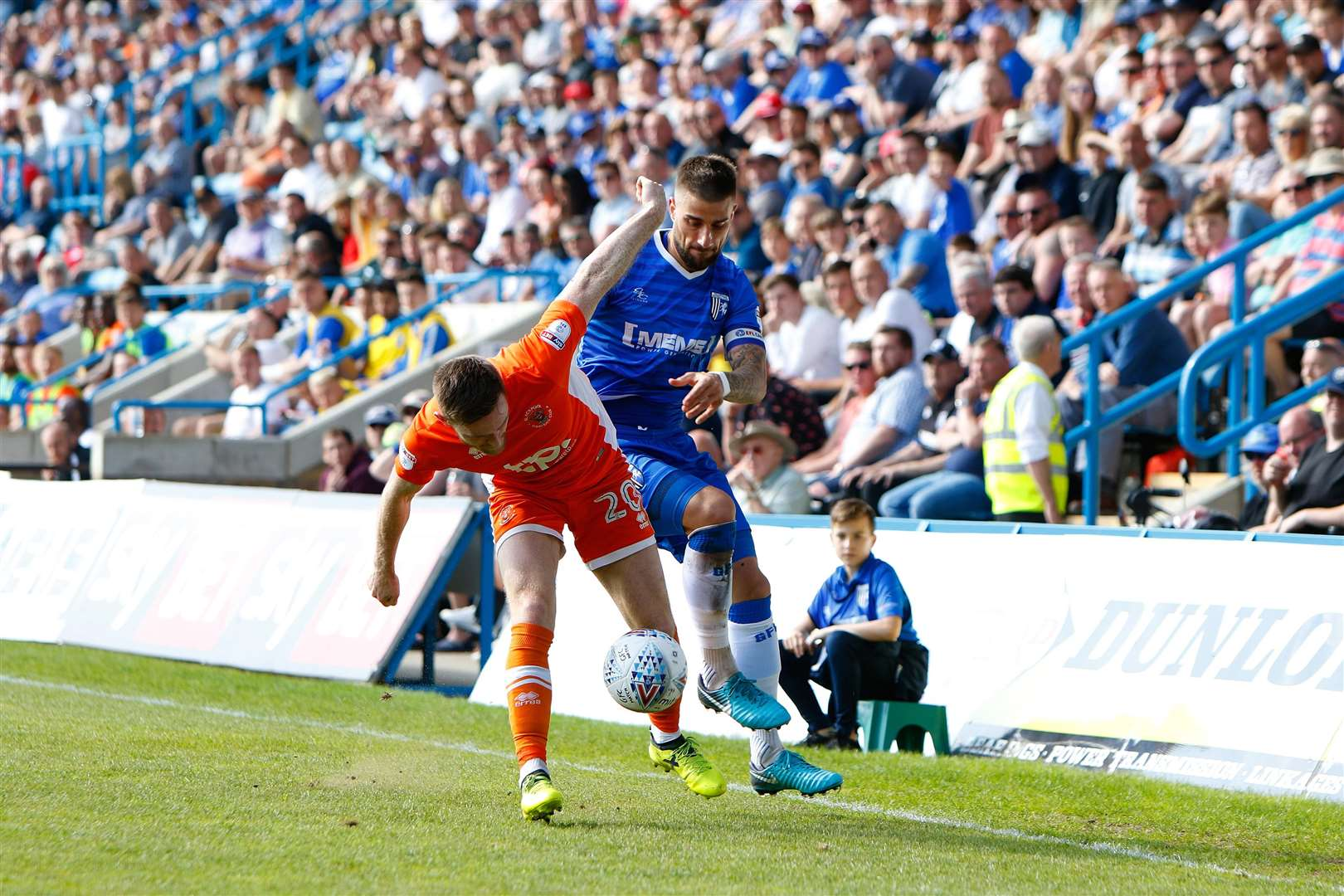 Gillingham defender Max Ehmer challenges Blackpool defender Oliver Turton Picture: Andy Jones