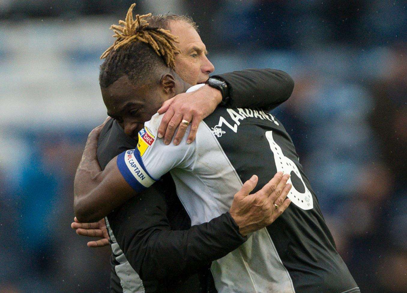 Manager Steve Lovell celebrates Gills' win on Saturday with skipper Gabriel Zakuani Picture: Ady Kerry