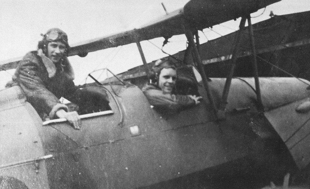 Second World War pilot Des Page (front) learning to fly in a Tiger Moth.