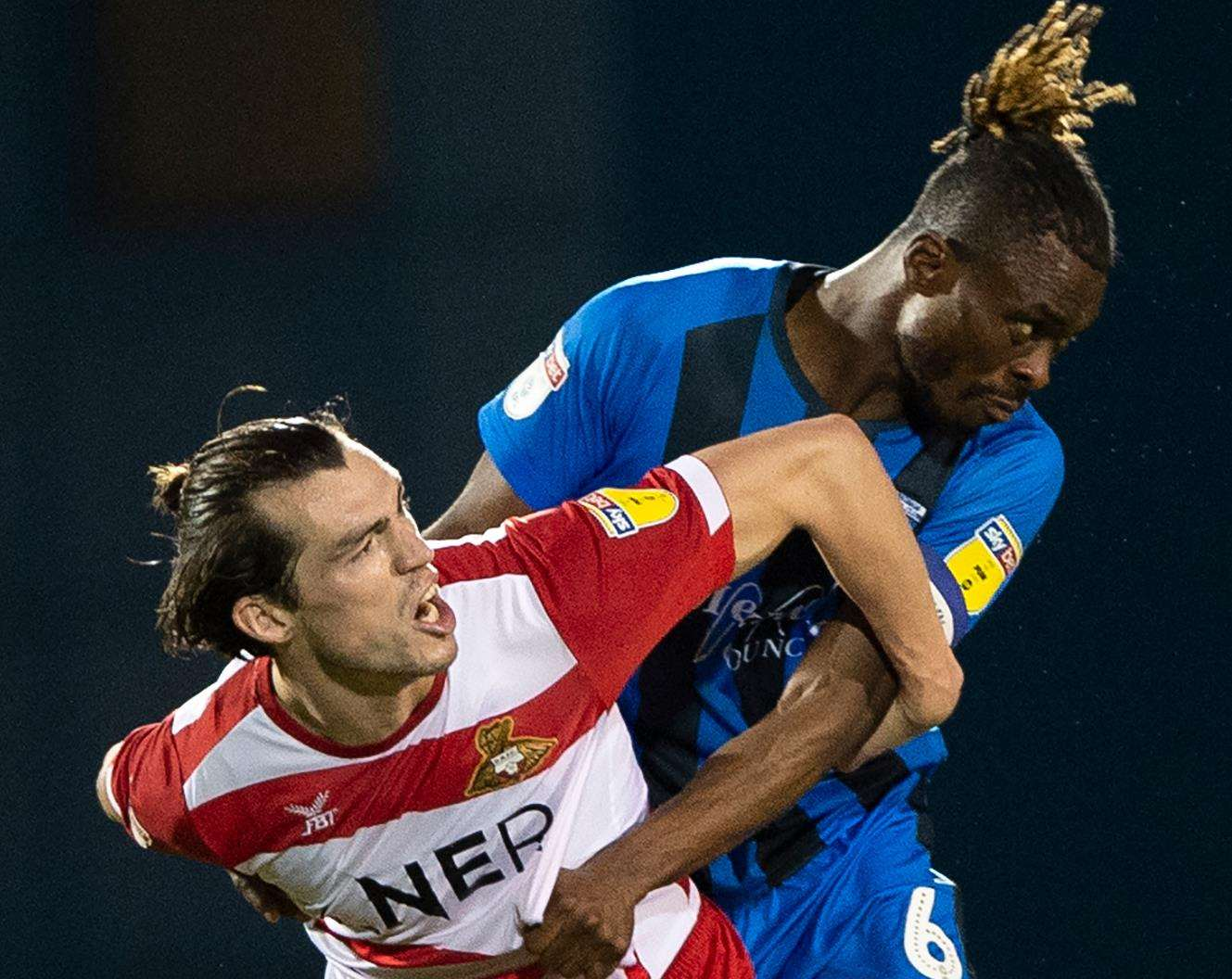 Gabriel Zakuani challenges with John Marquis Picture: Ady Kerry