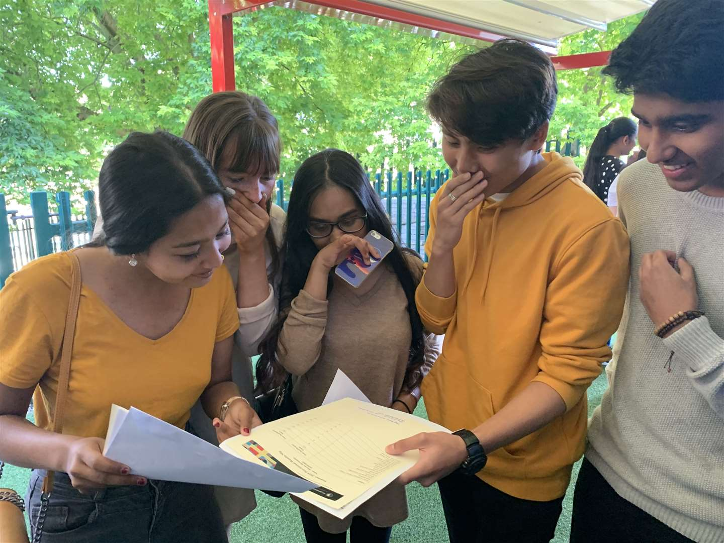 St John Fisher Catholic School pupils, including Marcus Hernandez in the yellow top, looking at their results (15600428)