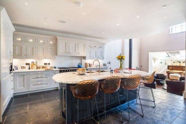 The kitchen inside the converted building. Picture: Zoopla / Strutt & Parker