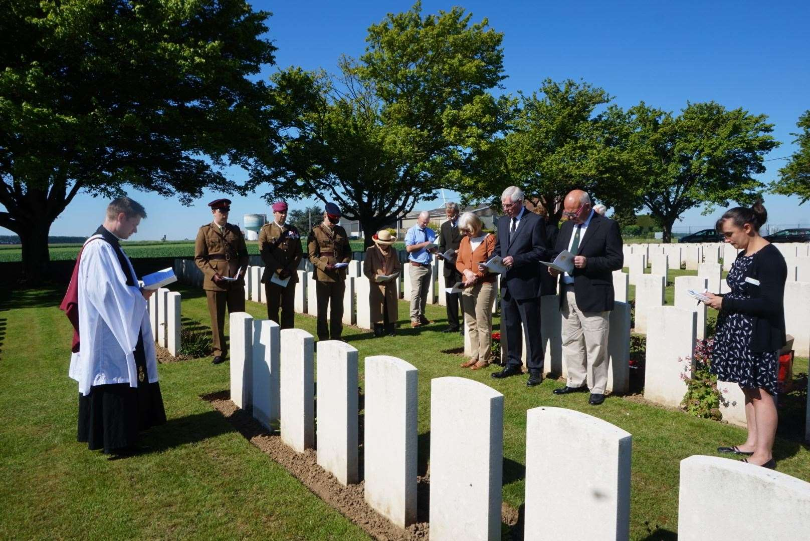 The Revd Ian Kemp CF conducts the rededication service for Capt Edwards at Gouzeaucourt New British Cemetery (10379455)
