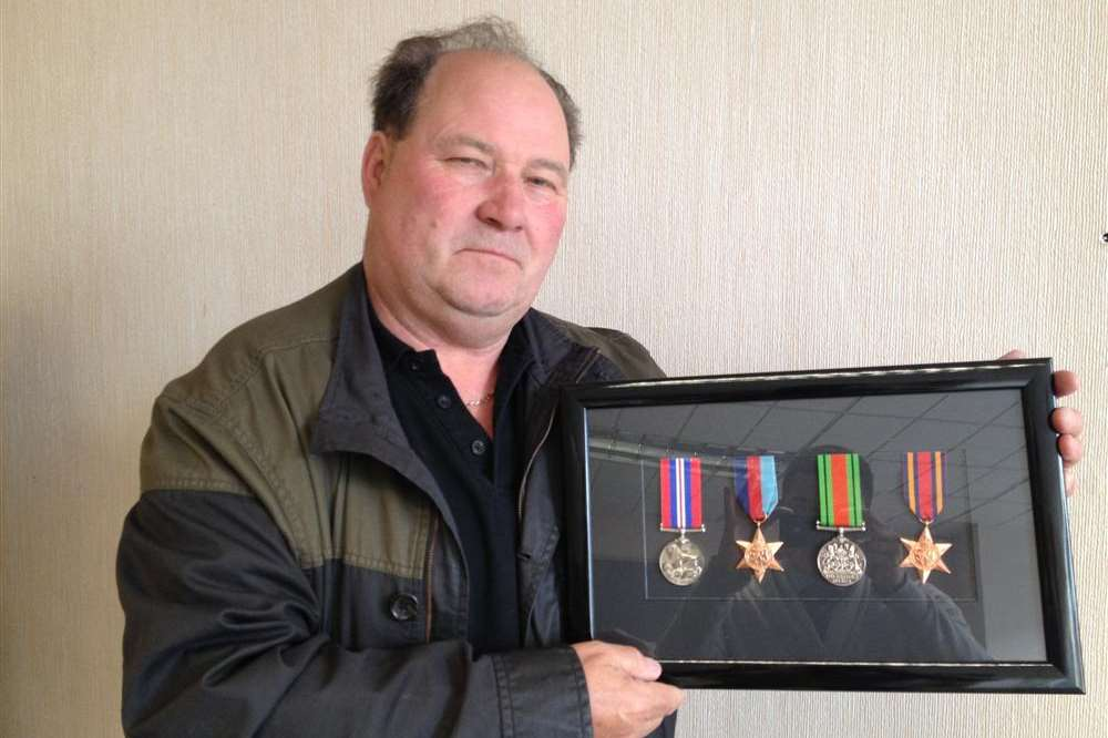 Colin Barker with the medals his father earned during the Second World War