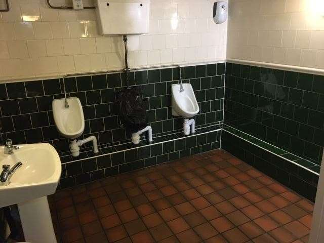 Decorated with dark green tiles and painted white, the toilets are well maintained, clean and fresh