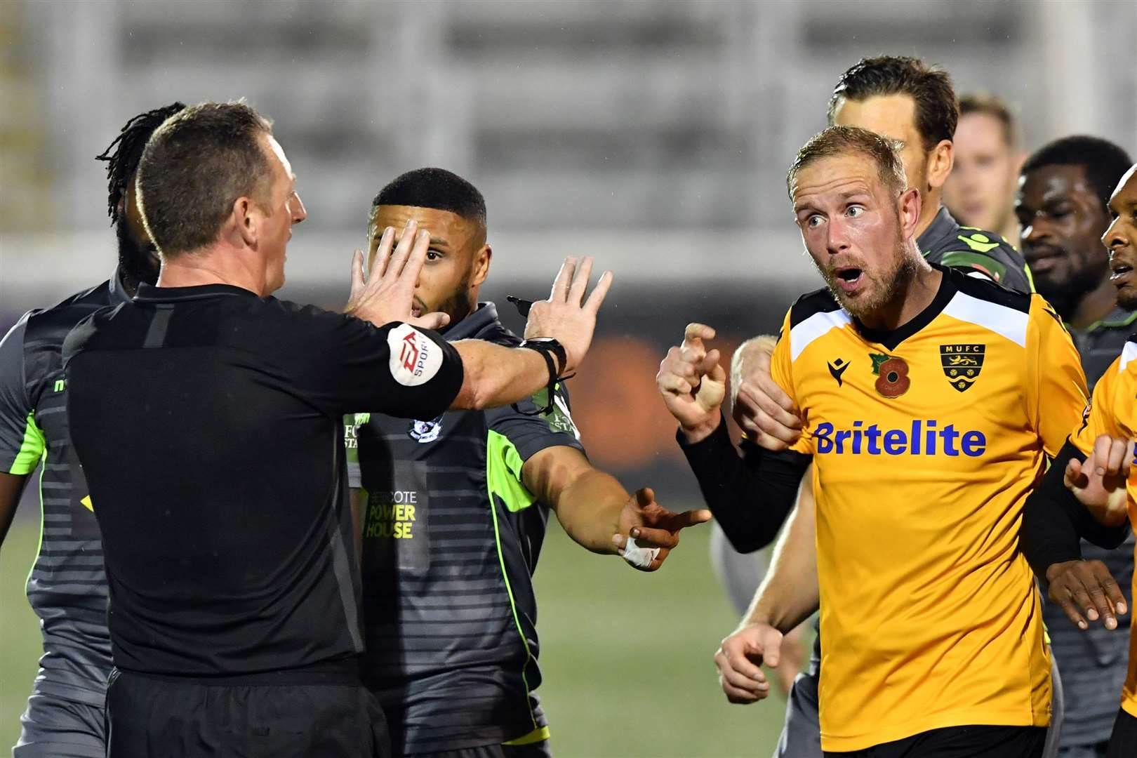 Referee Phil Staynings holds firm amid protests from Maidstone striker Scott Rendell Picture: Keith Gillard