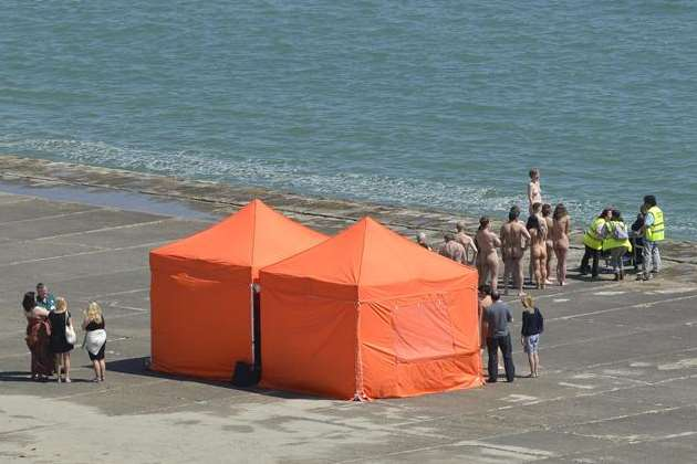 Naked volunteers line up on the beach at The Warren in Folkestone for Spencer Tunick. Picture: Gary Browne