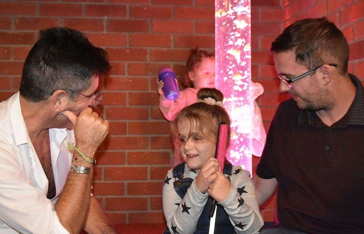 Hallie with X-Factor judge Simon Cowell. Pic: Demelza Children's Hospice