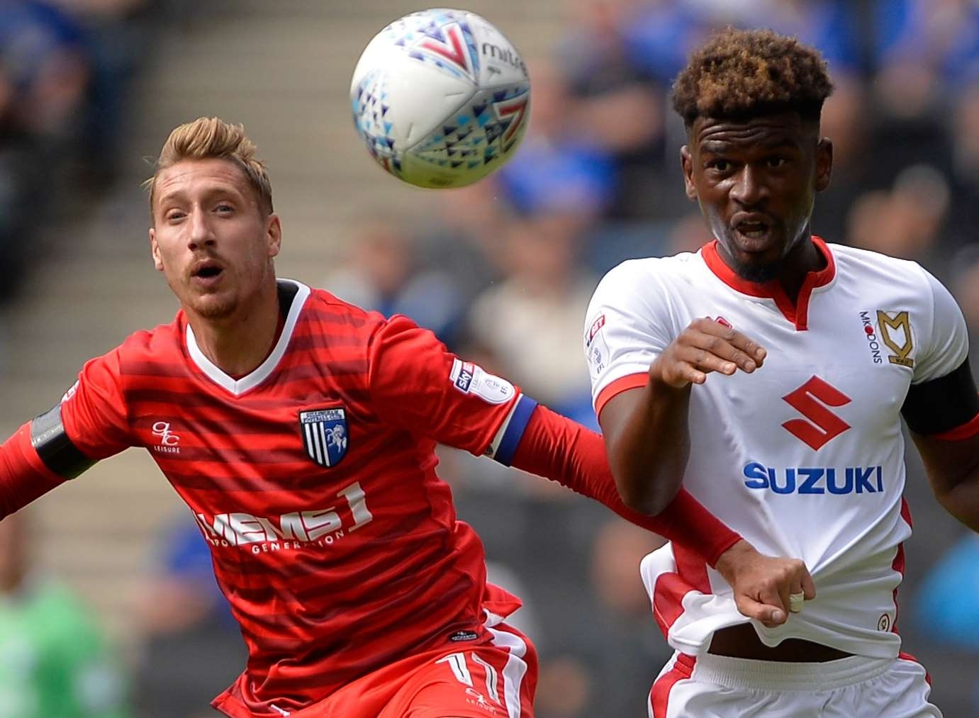 Gillingham's Lee Martin challenges with MK Dons' Aaron Tshibola. Picture: Ady Kerry
