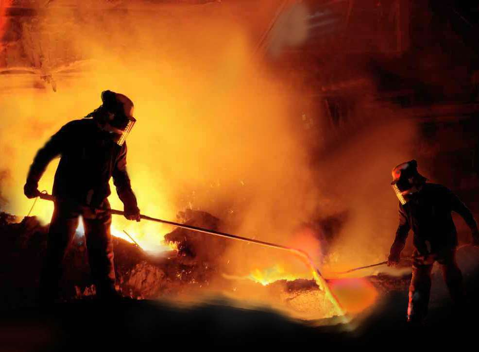 Fires of hell: Workers fuel molten steel with an oxygen lance at melting pot number three. Picture: Studio 137