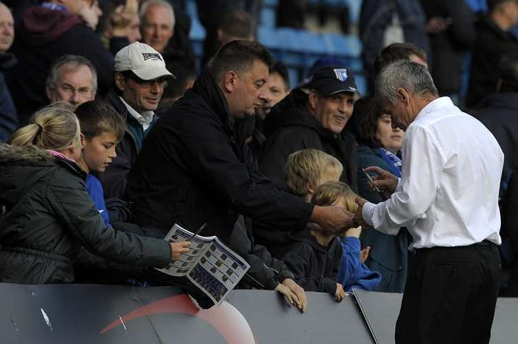 Peter Taylor signs autographs after the game Picture: Barry Goodwin